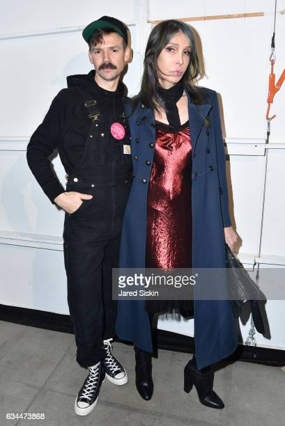 Adam Selman and guest pose backstage at the Adam Selman show during New York Fashion Week at Skylight Clarkson Sq on February 9, 2017 in New York...