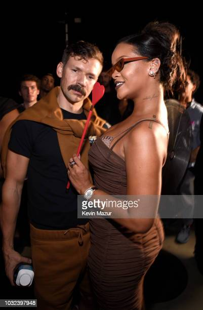 Adam Selman and Rihanna pose backstage for the Savage X Fenty Fall/Winter 2018 fashion show during NYFW at the Brooklyn Navy Yard on September 12...
