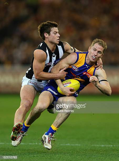 Adam Selwood of the Eagles is tackled by Jamie Elliott of the Magpies during the first AFL Semi Final match between the Collingwood Magpies and the...