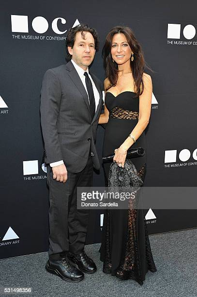 Adam Sender and Justine Low attend the MOCA Gala 2016 at The Geffen Contemporary at MOCA on May 14 2016 in Los Angeles California