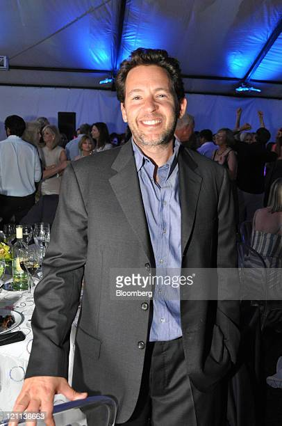 Adam Sender general partner and founder Exis Capital Management Inc stands for a photograph at the Parrish Art Museum Midsummer Party in South...