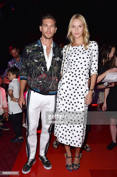 Adam Senn and Adriana Cernanova attend the Dolce Gabbana show during Milan Men's Fashion Week Spring/Summer 2018 on June 17 2017 in Milan Italy