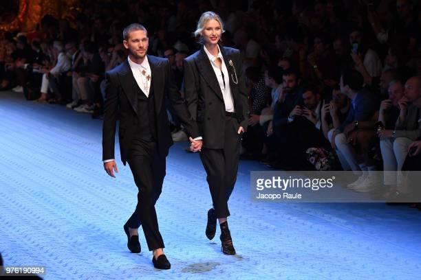 Adam Senn and Adriana Cernanova walk the runway at the Dolce Gabbana show during Milan Men's Fashion Week Spring/Summer 2019 on June 16 2018 in Milan...