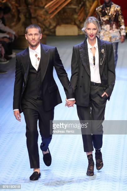 Adam Senn and Adriana Cernanova walks the runway at the Dolce Gabbana show during Milan Men's Fashion Week Spring/Summer 2019 on June 16 2018 in...