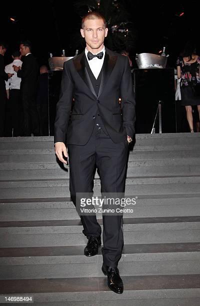 Adam Senn attends the Dolce Gabbana party as part of Milan Fashion Week Menswear Spring/Summer 2013 on June 24 2012 in Milan Italy