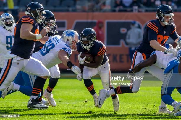 Adam Shaheen of the Chicago Bears blocks for Tarik Cohen in the first quarter against the Detroit Lions at Soldier Field on November 19 2017 in...