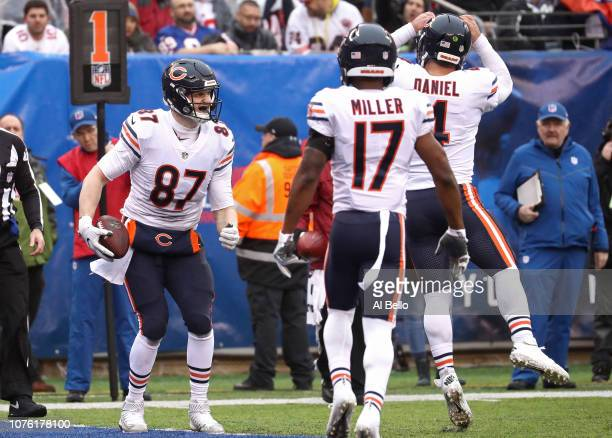 Adam Shaheen of the Chicago Bears is congratulated by teammates Anthony Miller and Chase Daniel after scoring a firstquarter touchdown against the...