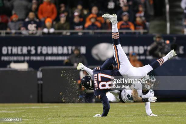 Adam Shaheen of the Chicago Bears tries to avoid the tackle of Cre'von LeBlanc of the Philadelphia Eagles in the second half of the NFC Wild Card...