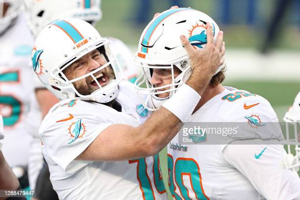 Adam Shaheen of the Miami Dolphins celebrates with Ryan Fitzpatrick after his touchdown against the New York Jets in the fourth quarter of their NFL...