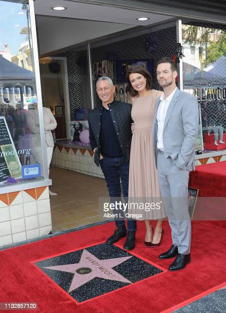 Adam Shankman Mandy Moore and Shane West pose together at Mandy Moore's Star Ceremony On The Hollywood Walk Of Fame on March 25 2019 in Hollywood...