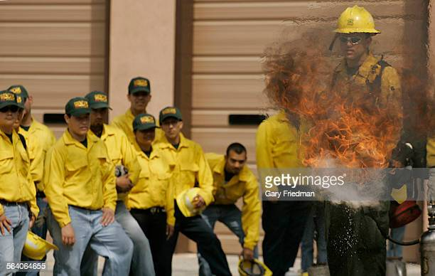 Adam Shepard is a firefighter with US Forest Service and demonstrates how to light a backfire to approximately 100 LAUSD high school students who...