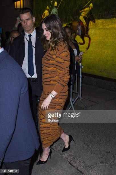 Adam Shulman and Anne Hathaway are seen in Midtown on May 22 2018 in New York City