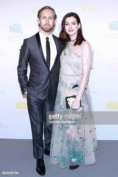 Adam Shulman and Anne Hathaway at the 2016 Guggenheim International Gala at Solomon R Guggenheim Museum on November 17 2016 in New York City