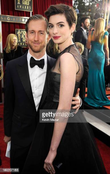 Adam Shulman and Anne Hathaway attend the 19th Annual Screen Actors Guild Awards at The Shrine Auditorium on January 27 2013 in Los Angeles...