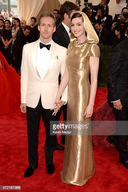 "Adam Shulman and Anne Hathaway attend the ""China: Through The Looking Glass"" Costume Institute Benefit Gala at Metropolitan Museum of Art on May 4,..."