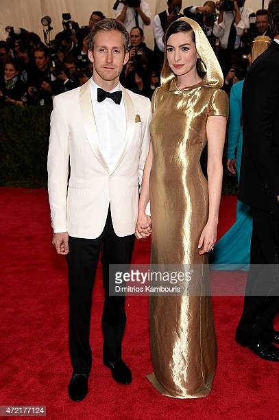 Adam Shulman and Anne Hathaway attend the China Through The Looking Glass Costume Institute Benefit Gala at the Metropolitan Museum of Art on May 4...
