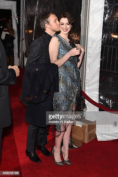 Adam Shulman and Anne Hathaway attend the 'Interstellar' New York premiere at AMC Lincoln Square Theater on November 3 2014 in New York City