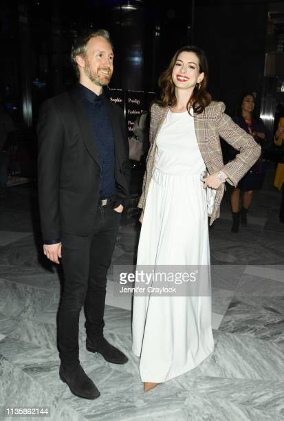 Adam Shulman and Anne Hathaway attend the Watches Of Switzerland Hudson Yards opening on March 14 2019 at Hudson Yards in New York City