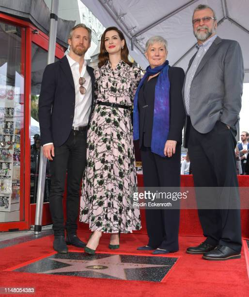 Adam Shulman Anne Hathaway Kate McCauley Hathaway and Richard Hathaway pose for portrait at Anne Hathaway Honored With Star On The Hollywood Walk Of...