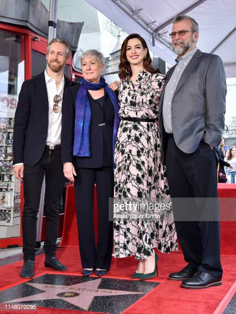 Adam Shulman Kate McCauley Hathaway Anne Hathaway and Gerald Hathaway attend the ceremony honoring Anne Hathaway with star on the Hollywood Walk of...