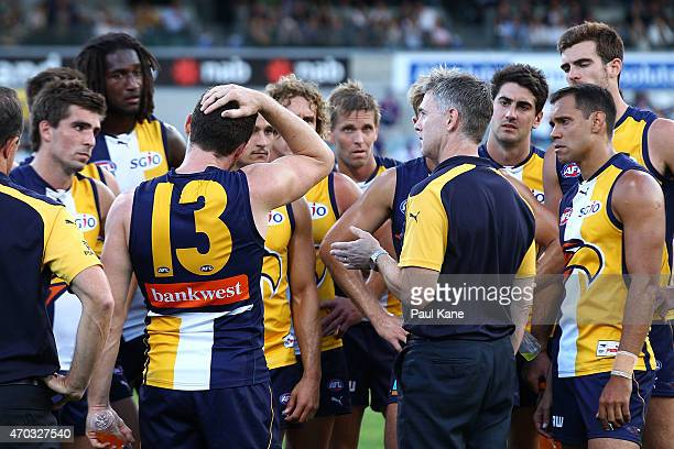 Adam Simpson coach of the Eagles addresses his players after being defeated during the round three AFL match between the West Coast Eagles and the...