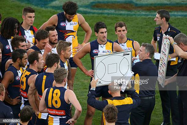 Adam Simpson coach of the Eagles addresses his team at the three quarter time break during the round 13 AFL match between the West Coast Eagles and...