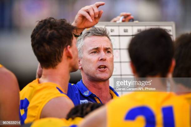 Adam Simpson coach of the Eagles addresses the team at quarter time during the 2018 AFL round six match between the Fremantle Dockers and the West...