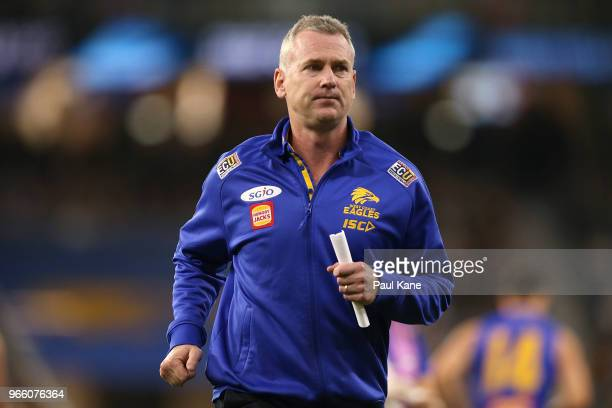 Adam Simpson coach of the Eagles jogs from the field following the quarter time break during the round 11 AFL match between the West Coast Eagles and...