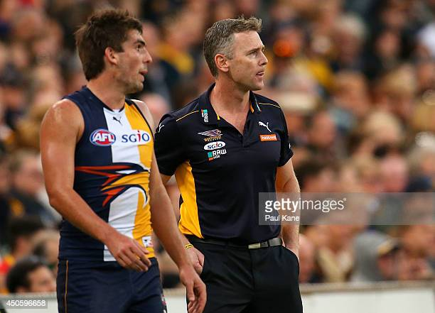 Adam Simpson coach of the Eagles looks from the sidelines during the round 13 AFL match between the West Coast Eagles and the Gold Coast Suns at...