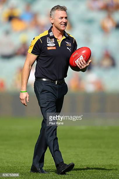 Adam Simpson coach of the Eagles looks on as players warm up during the round six AFL match between the West Coast Eagles and the Collingwood Magpies...