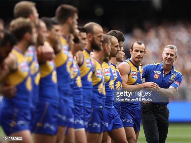 Adam Simpson Senior Coach of the Eagles and Shannon Hurn of the Eagles looks on before during the 2018 AFL Grand Final match between the Collingwood...