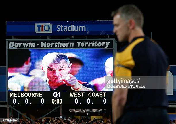 Adam Simpson Senior Coach of the Eagles looks on as a tribute to Phil Walsh is played during the 2015 AFL round 14 match between the Melbourne Demons...