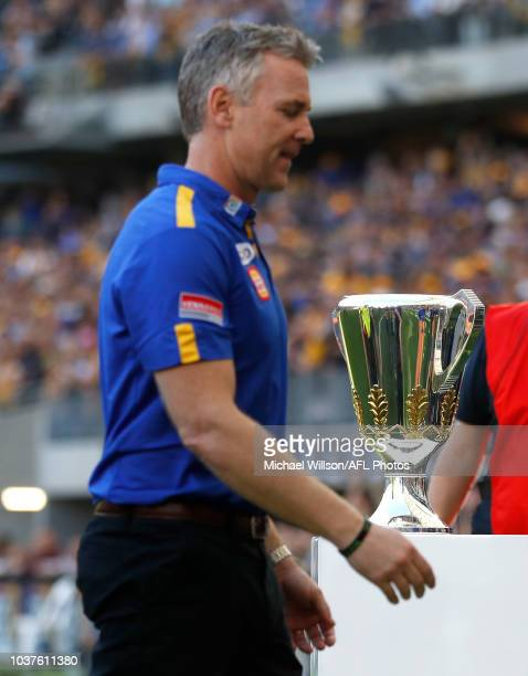 Adam Simpson Senior Coach of the Eagles walks past the premiership cup during the 2018 AFL Second Preliminary Final match between the West Coast...