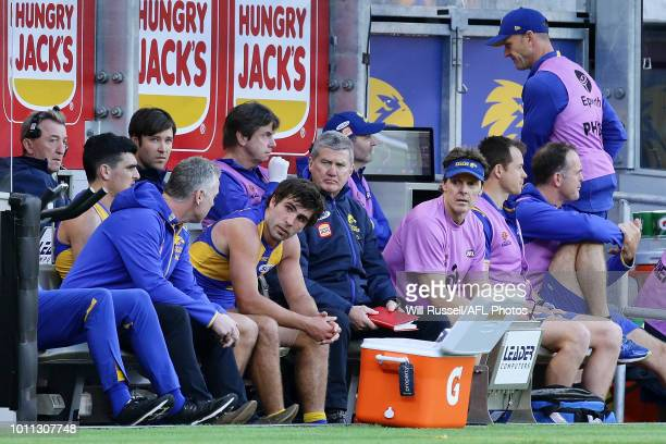 Adam Simpson Senior Coach speaks to Andrew Gaff of the Eagles on the bench after his incident with Andrew Brayshaw of the Dockers during the round 20...