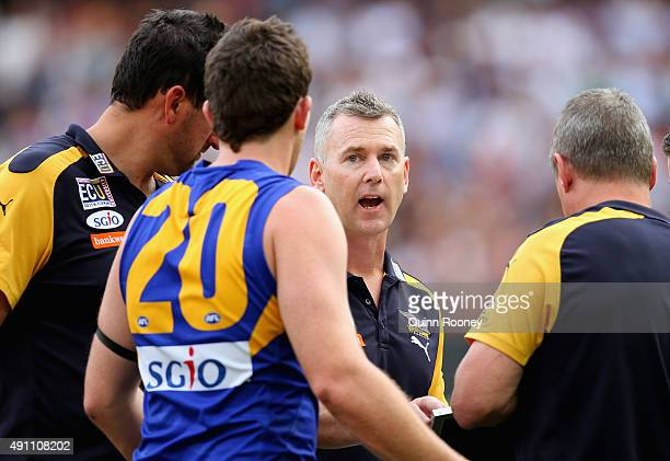 Adam Simpson the coach of the Eagles talks to Jeremy McGovern during the 2015 AFL Grand Final match between the Hawthorn Hawks and the West Coast...