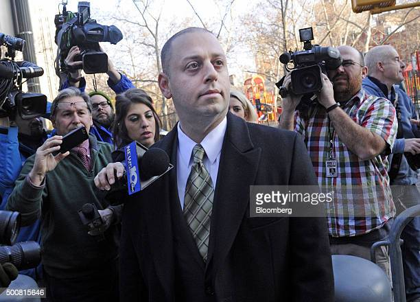 Adam Skelos son of former New York State Senate Majority Leader Dean Skelos is surrounded by members of the media while arriving at federal court in...