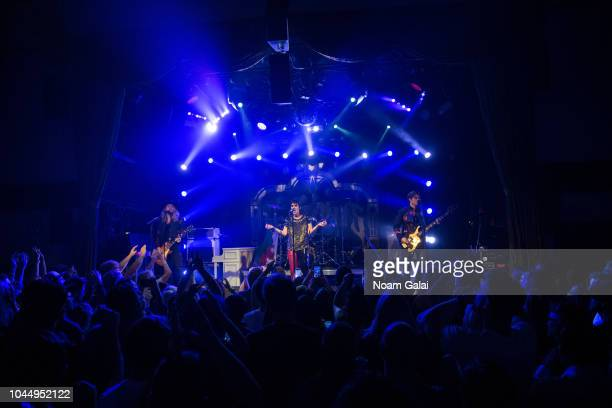 Adam Slack Gethin Davies Luke Spiller and Jed Elliott of The Struts performs in concert at Bowery Ballroom on October 2 2018 in New York City