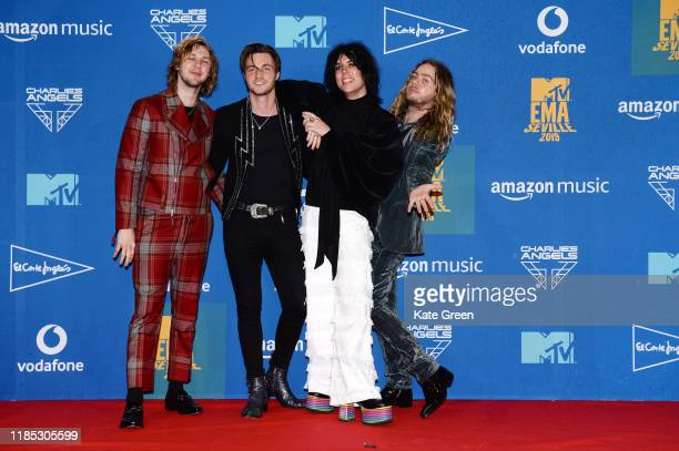 Adam Slack Luke Spiller Jed Elliott and Gethin Davies of The Struts pose in the winners room during the MTV EMAs 2019 at FIBES Conference and...