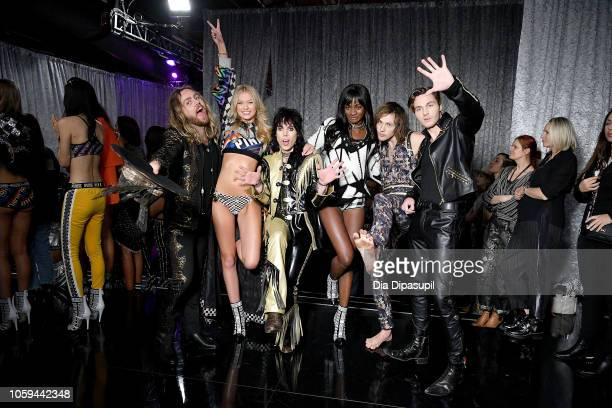 Adam Slack Maggie Laine Luke Spiller Zuri Tibby Gethin Davies and Jed Elliott pose backstage during the 2018 Victoria's Secret Fashion Show at Pier...