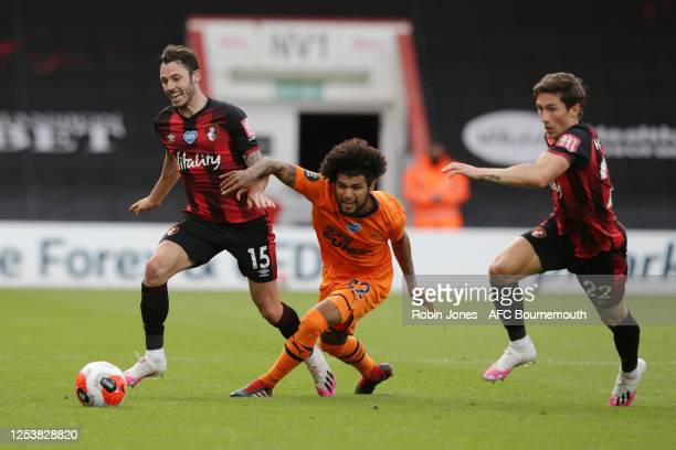 Adam Smith and Harry Wilson of Bournemouth with DeAndre Yedlin of Newcastle United during the Premier League match between AFC Bournemouth and...