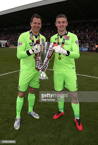 Adam Smith and Ryan Clarke of Northampton Town celebrate with the Sky Bet League Two champions trophy after the Sky Bet League Two match between...