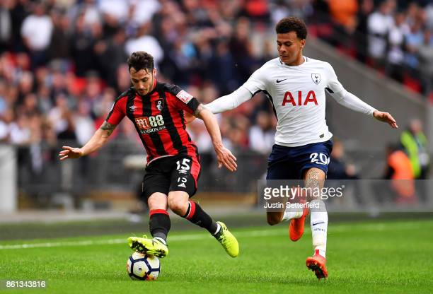 Adam Smith of AFC Bournemouth and Dele Alli of Tottenham Hotspur during the Premier League match between Tottenham Hotspur and AFC Bournemouth at...
