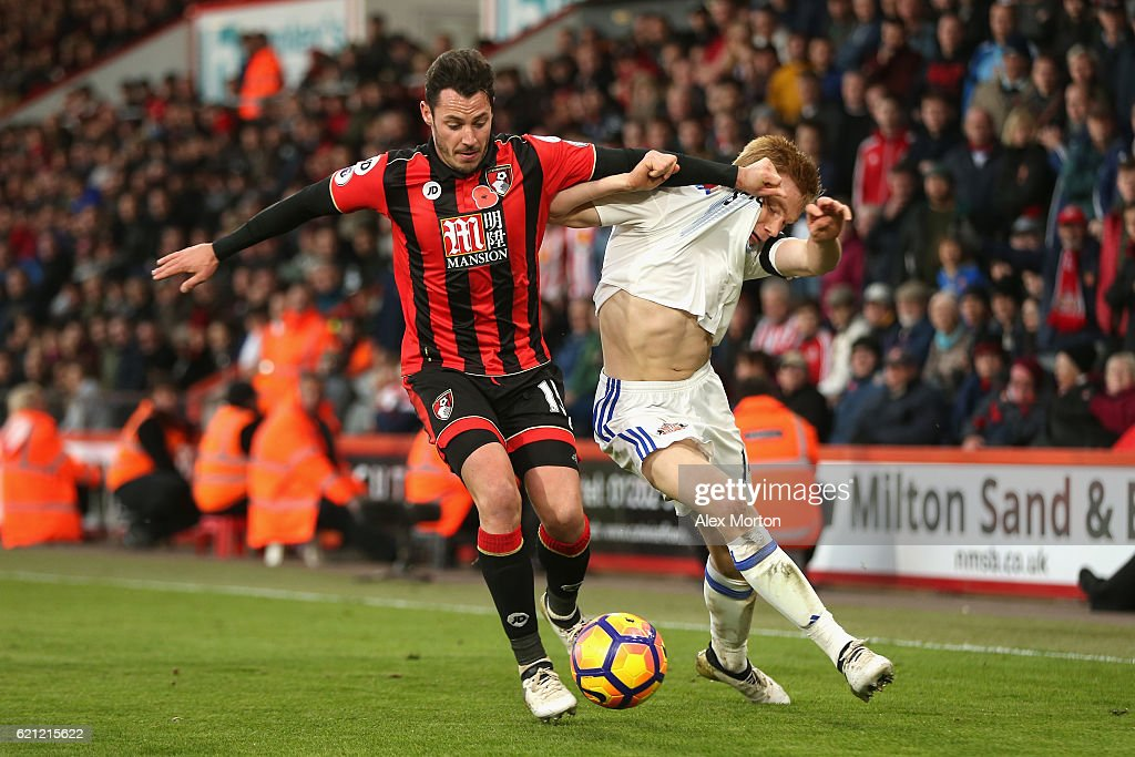 Adam Smith of AFC Bournemouth (L) and Duncan Watmore of Sunderland (R) battle for possession during the Premier League match between AFC Bournemouth and Sunderland at Vitality Stadium on November 5, 2016 in Bournemouth, England.