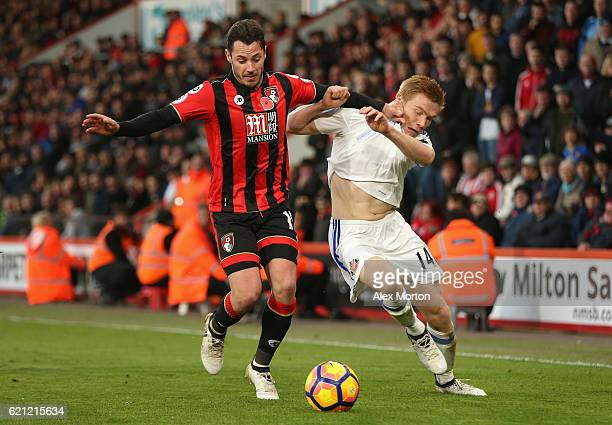 Adam Smith of AFC Bournemouth and Duncan Watmore of Sunderland battle for possession during the Premier League match between AFC Bournemouth and...