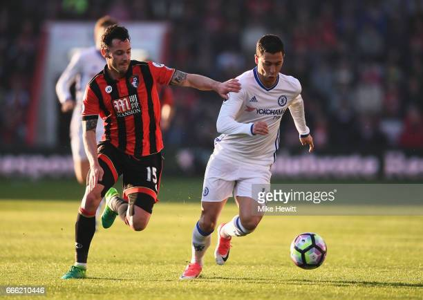 Adam Smith of AFC Bournemouth and Eden Hazard of Chelsea battle for possession during the Premier League match between AFC Bournemouth and Chelsea at...