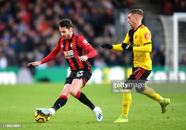Adam Smith of AFC Bournemouth and Gerard Deulofeu of Watford battle for possession during the Premier League match between AFC Bournemouth and...