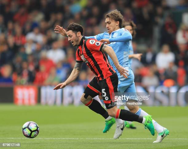 Adam Smith of AFC Bournemouth and Marc Muniesa of Stoke City battle for possession during the Premier League match between AFC Bournemouth and Stoke...