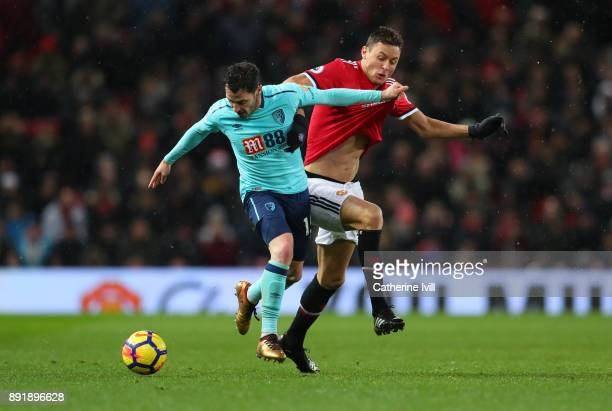Adam Smith of AFC Bournemouth and Nemanja Matic of Manchester United during the Premier League match between Manchester United and AFC Bournemouth at...
