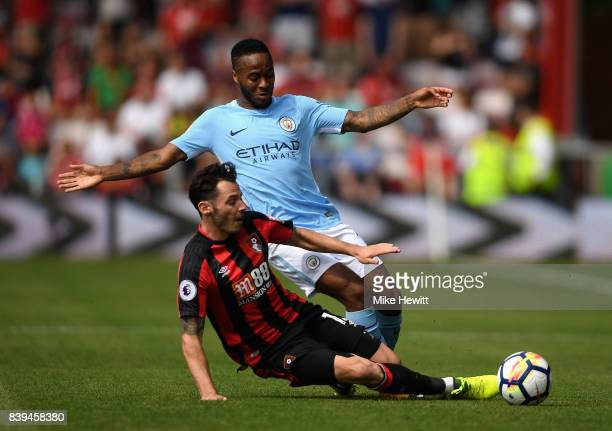 Adam Smith of AFC Bournemouth and Raheem Sterling of Manchester City battle for possession during the Premier League match between AFC Bournemouth...
