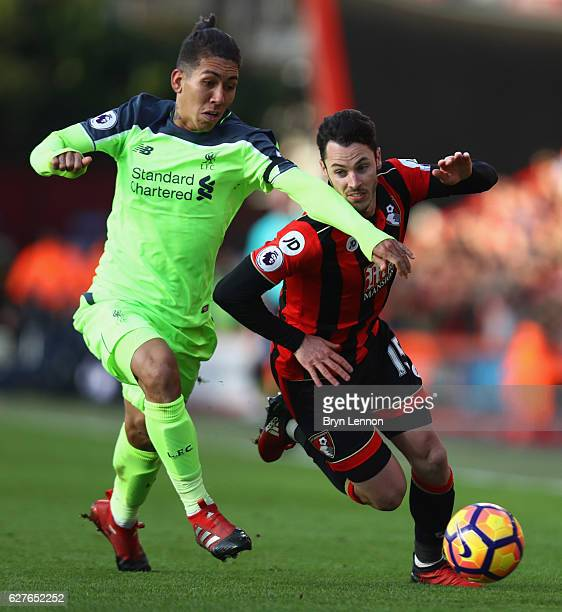 Adam Smith of AFC Bournemouth and Roberto Firmino of Liverpool battle for the ball during the Premier League match between AFC Bournemouth and...